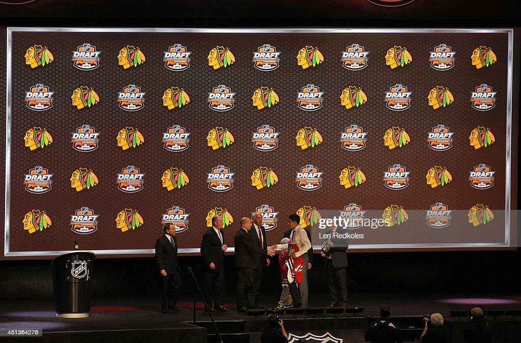 Nick Schmaltz, 20th overall pick of the Chicago Blackhawks, is greeted onstage by members of the Chicago Blackhawks organization during the 2014 NHL Entry Draft at Wells Fargo Center on June 27, 2014 in Philadelphia, Pennsylvania.