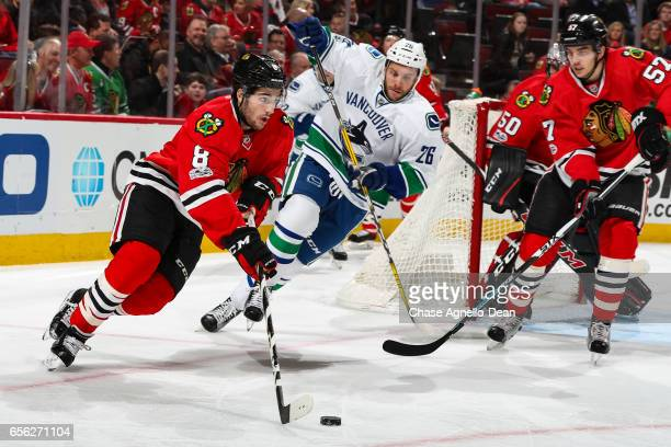 Nick Schmaltz of the Chicago Blackhawks approaches the puck ahead of Joseph Cramarossa of the Vancouver Canucks in the first period at the United...