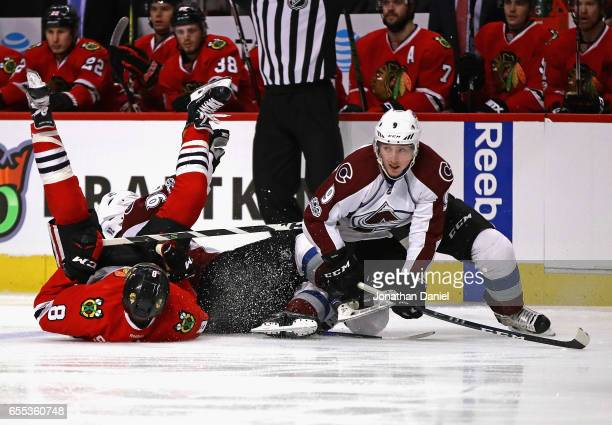 Nick Schmaltz of the Chicago Blackhawks Gabriel Landeskog and Matt Duchene of the Colorado Avalanche hits the ice after colliding at the United...