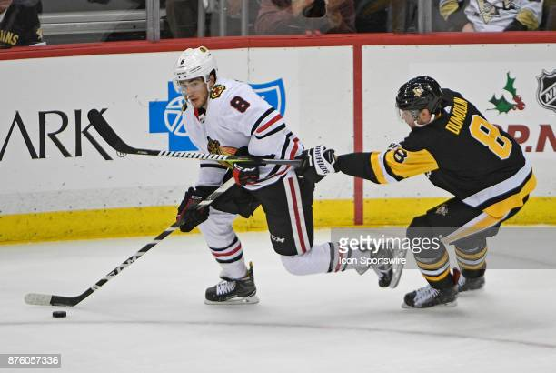 Nick Schmaltz of the Chicago Blackhawks handles the puck while being defended by Brian Dumoulin of the Pittsburgh Penguins in the second period...