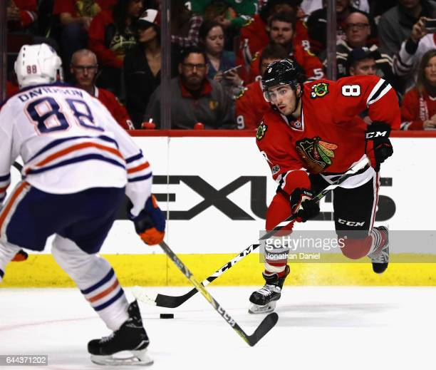 Nick Schmaltz of the Chicago Blackhawks moves Brandon Davidson of the Edmonton Oilers at the United Center on February 18 2017 in Chicago Illinois...