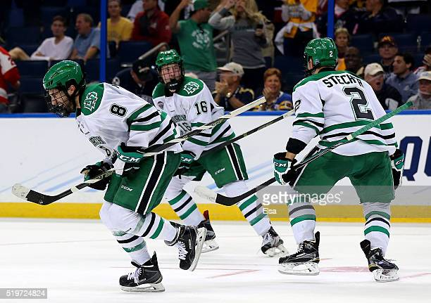 Nick Schmaltz of the North Dakota Fighting Hawks celebrates his game winning goal with teammates Brock Boeser and Troy Stecher in the third period...