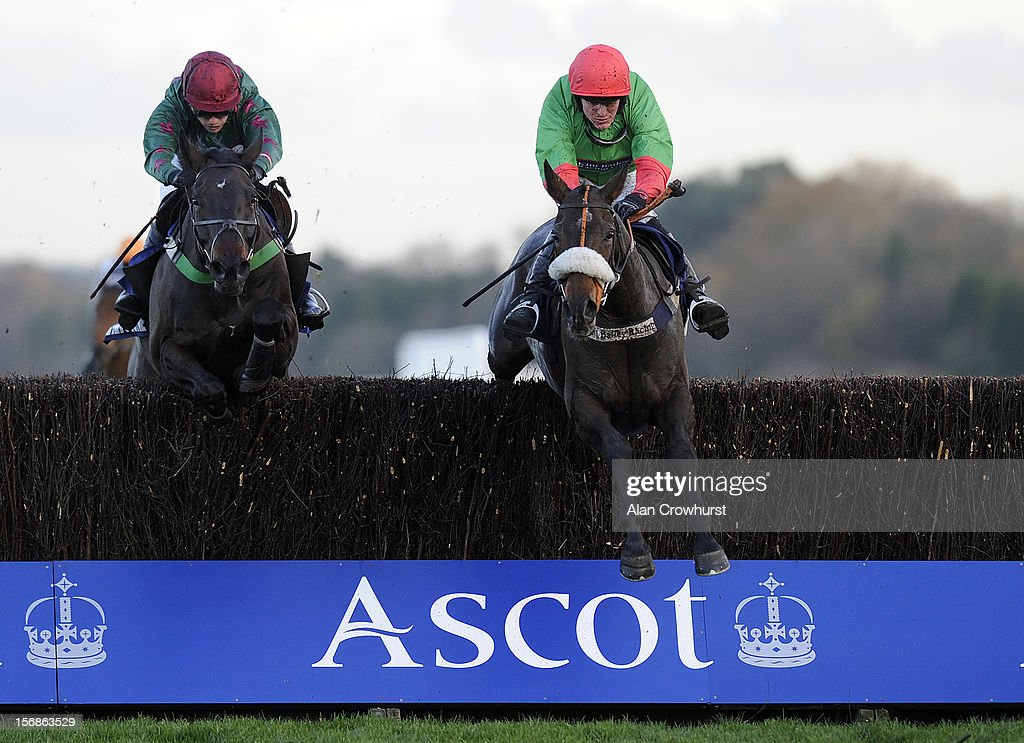Nick Schofield riding The Rainbow Hunter (R) clear the last to win The Mitie Events & Leisure Handicap Steeple Chase from Loch Ba (L) at Ascot racecourse on November 23, 2012 in Ascot, England.