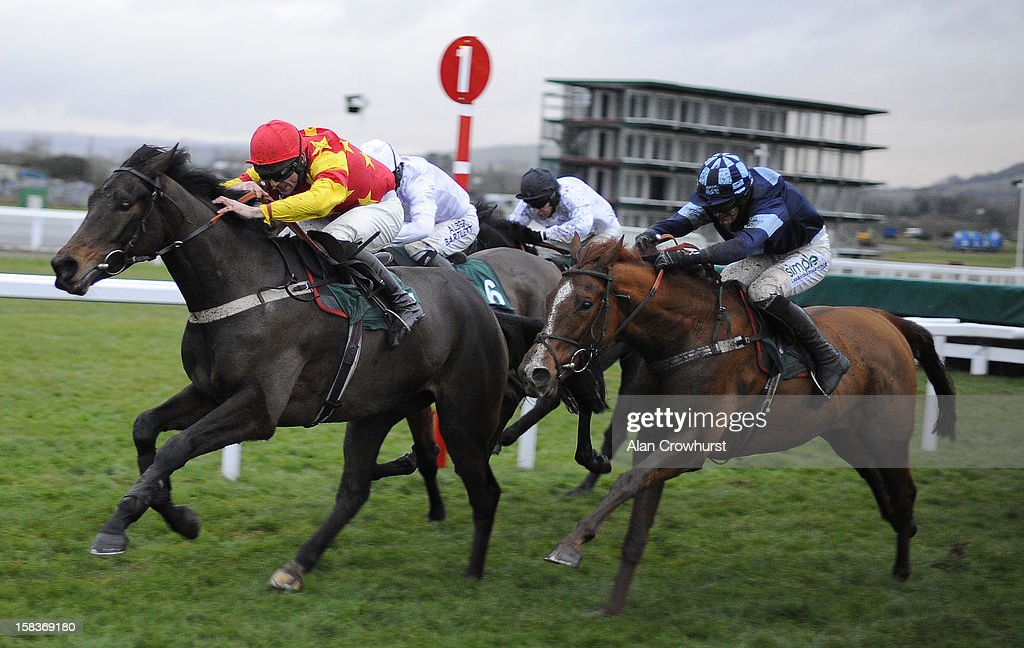 Nick Scholfield riding Melodic Rendezvous (R) clear the last to win The British Stallion Studs/Pyments Quantity Surveyors EBF 'National Hunt' Novices' Hurdle Race at Cheltenham racecourse on December 14, 2012 in Cheltenham, England.