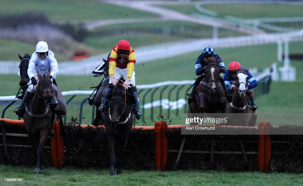 Nick Scholfield riding Melodic Rendezvous (2R) clear the last to win The British Stallion Studs/Pyments Quantity Surveyors EBF 'National Hunt' Novices' Hurdle Race at Cheltenham racecourse on December 14, 2012 in Cheltenham, England.