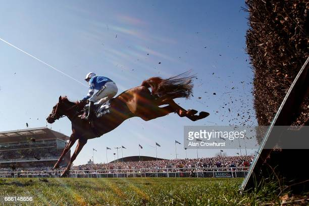 Nick Scholfield riding San Benedeto on their way to winning The Doom Bar Maghull Novicesâ Steeple Chase at Aintree Racecourse on April 8 2017 in...