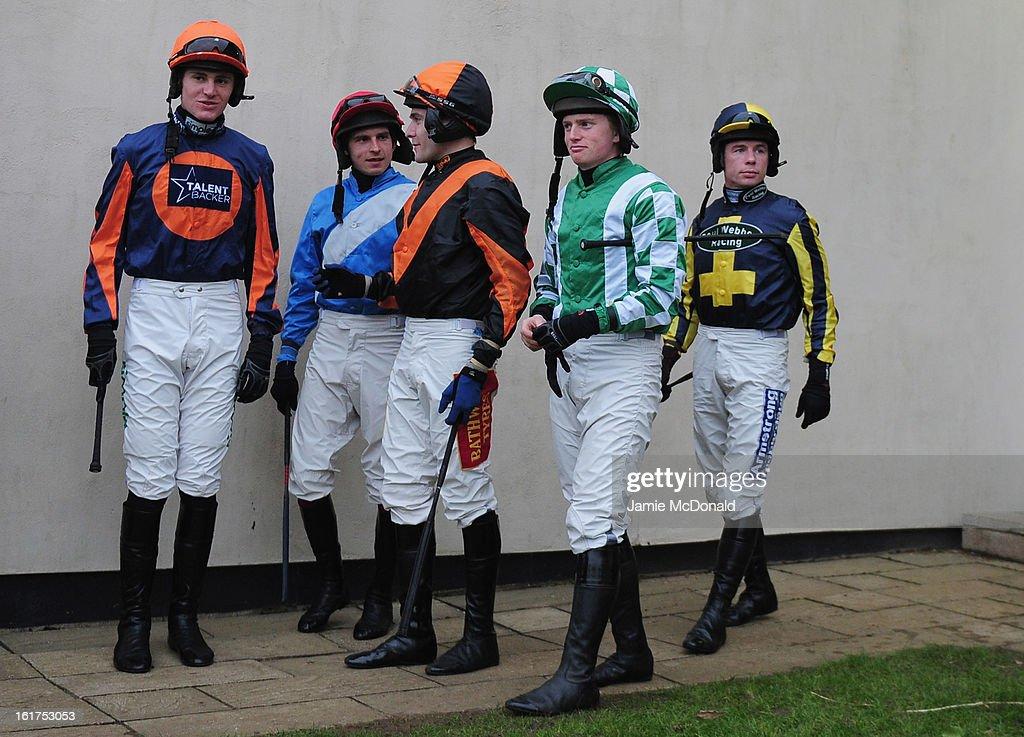 Nick Scholfield (orange hat) with jockeys on February 15, 2013 in Fakenham, England.