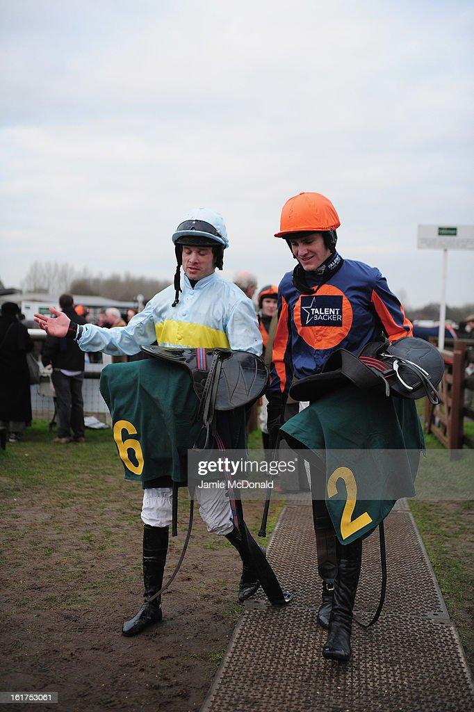 Nick Scholfield (orange hat) with <a gi-track='captionPersonalityLinkClicked' href=/galleries/search?phrase=Sam+Thomas+-+Jockey&family=editorial&specificpeople=15316251 ng-click='$event.stopPropagation()'>Sam Thomas</a> on February 15, 2013 in Fakenham, England.