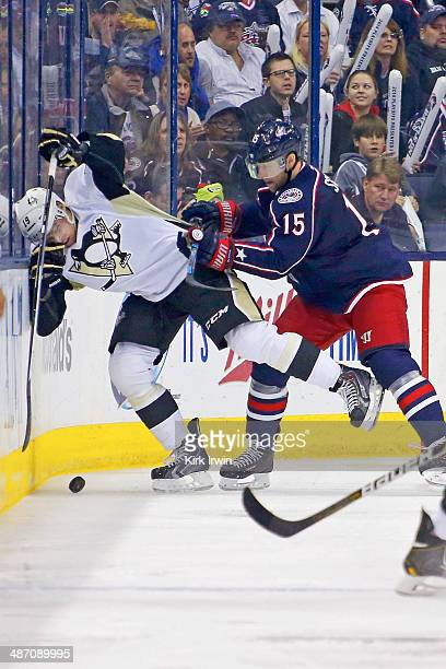 Nick Schultz of the Columbus Blue Jackets checks Beau Bennett of the Pittsburgh Penguins while battling for control of the puck during Game Four of...