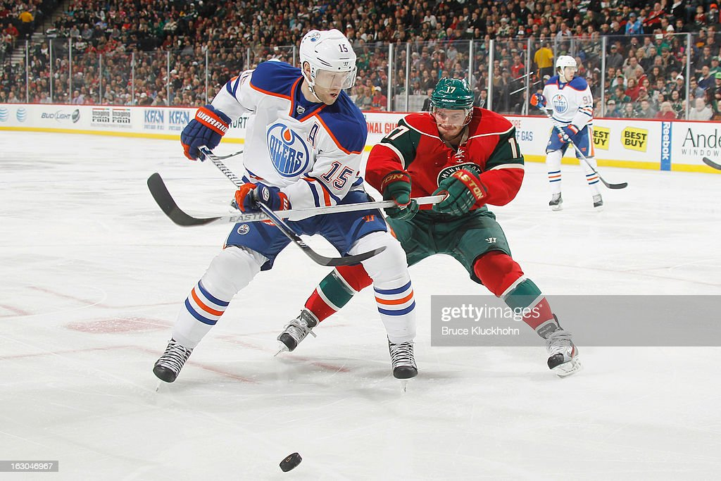 <a gi-track='captionPersonalityLinkClicked' href=/galleries/search?phrase=Nick+Schultz&family=editorial&specificpeople=203252 ng-click='$event.stopPropagation()'>Nick Schultz</a> #15 of the Edmonton Oilers and <a gi-track='captionPersonalityLinkClicked' href=/galleries/search?phrase=Torrey+Mitchell&family=editorial&specificpeople=4504539 ng-click='$event.stopPropagation()'>Torrey Mitchell</a> #17 of the Minnesota Wild battle for a loose puck during the game on March 3, 2013 at the Xcel Energy Center in Saint Paul, Minnesota.