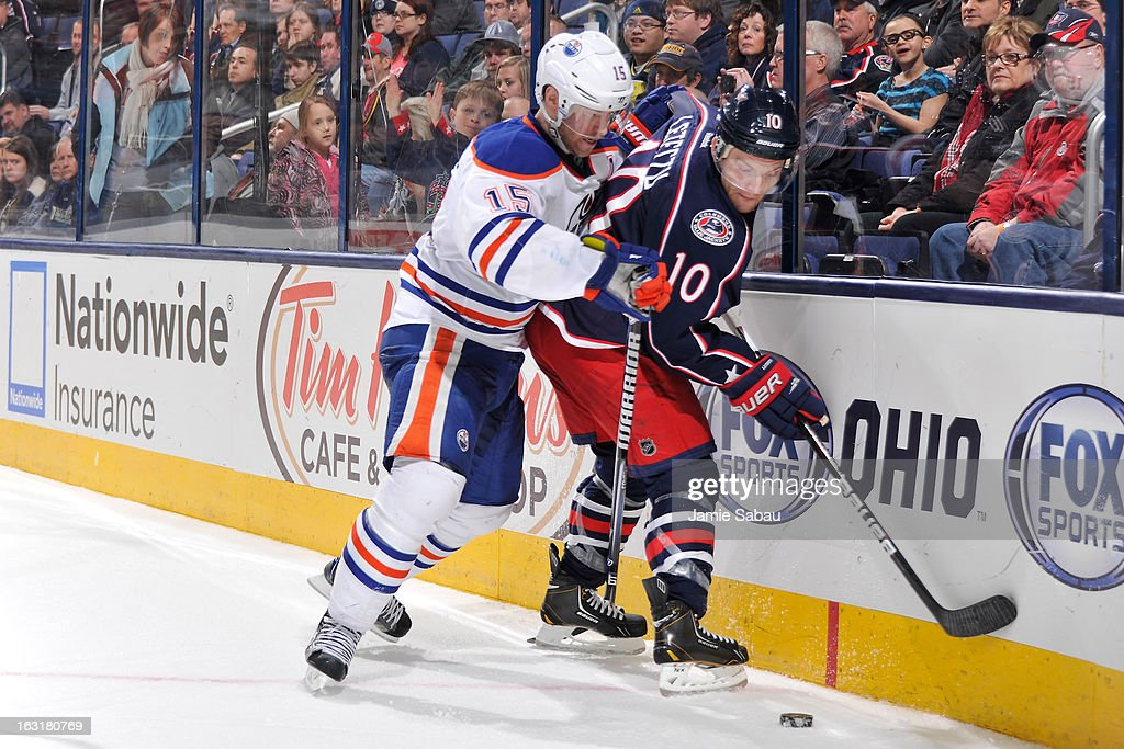 <a gi-track='captionPersonalityLinkClicked' href=/galleries/search?phrase=Nick+Schultz&family=editorial&specificpeople=203252 ng-click='$event.stopPropagation()'>Nick Schultz</a> #15 of the Edmonton Oilers battles for control of the puck with <a gi-track='captionPersonalityLinkClicked' href=/galleries/search?phrase=Mark+Letestu&family=editorial&specificpeople=4601071 ng-click='$event.stopPropagation()'>Mark Letestu</a> #10 of the Columbus Blue Jackets during the third period on March 5, 2013 at Nationwide Arena in Columbus, Ohio. Columbus defeated Edminton 4-3 in a shootout.