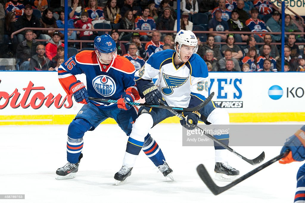 <a gi-track='captionPersonalityLinkClicked' href=/galleries/search?phrase=Nick+Schultz&family=editorial&specificpeople=203252 ng-click='$event.stopPropagation()'>Nick Schultz</a> #15 of the Edmonton Oilers battles for position against Magnus Paajarvi #56 of the St. Louis Blues on December 21, 2013 at Rexall Place in Edmonton, Alberta, Canada.