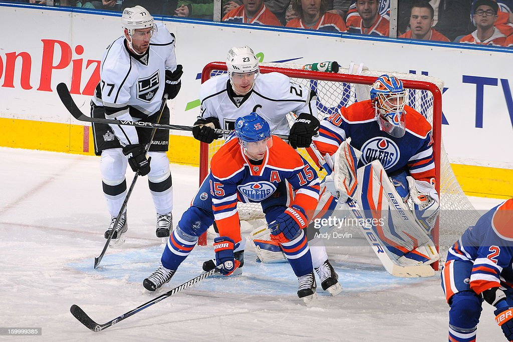 Nick Schultz #15 of the Edmonton Oilers battles for position in front of the net against Dustin Brown #23 and Jeff Carter #77 of the Los Angeles Kings at Rexall Place on January 24, 2013 in Edmonton, Alberta, Canada.