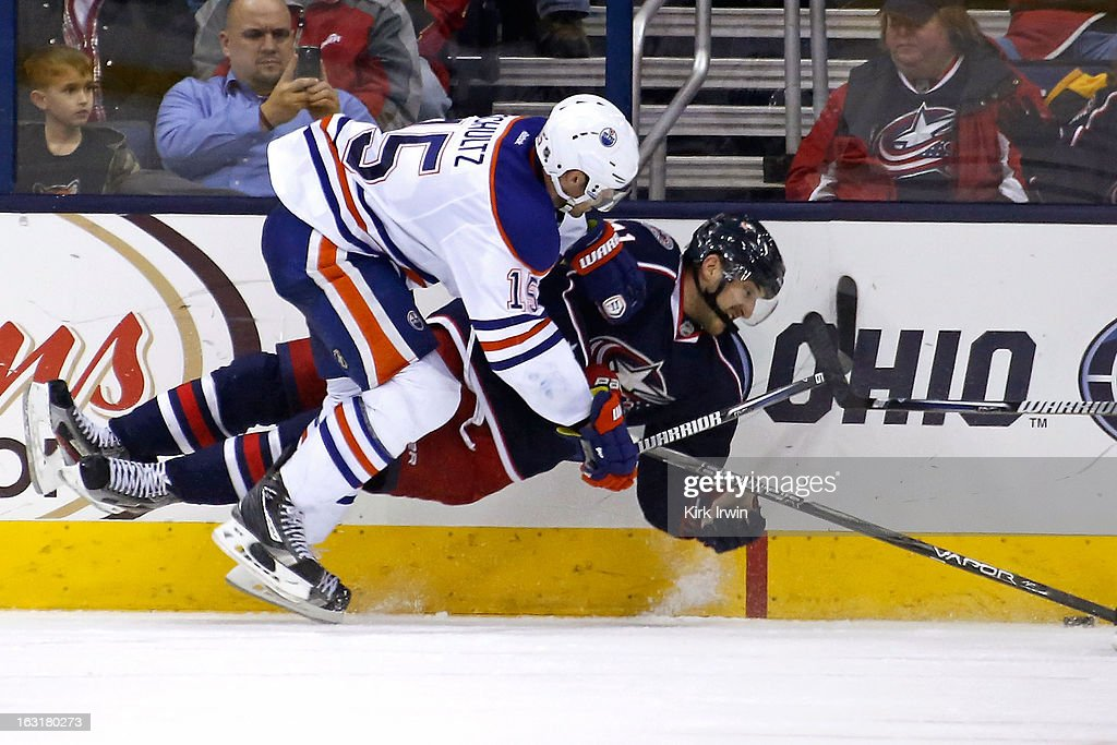<a gi-track='captionPersonalityLinkClicked' href=/galleries/search?phrase=Nick+Schultz&family=editorial&specificpeople=203252 ng-click='$event.stopPropagation()'>Nick Schultz</a> #15 of the Edmonton Oilers knocks down <a gi-track='captionPersonalityLinkClicked' href=/galleries/search?phrase=Nick+Foligno&family=editorial&specificpeople=537821 ng-click='$event.stopPropagation()'>Nick Foligno</a> #71 of the Columbus Blue Jackets during the overtime period on March 5, 2013 at Nationwide Arena in Columbus, Ohio. Columbus defeated Edmonton 4-3 in a shootout.