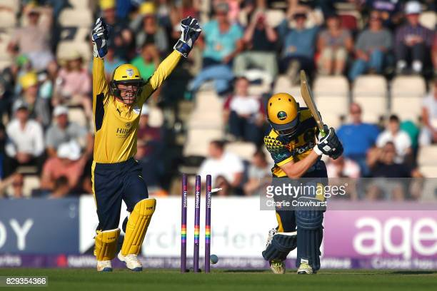 Nick Selman of Glamorgan is bowled out by Mason Crane of Hampshire while wicket keeper Calvin Dickinson celebrates during the NatWest T20 Blast match...