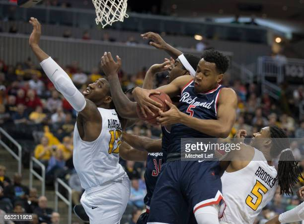 Nick Sherod of the Richmond Spiders grabs a rebound against Mo AlieCox and Doug Brooks of the Virginia Commonwealth Rams in the Semifinals of the...