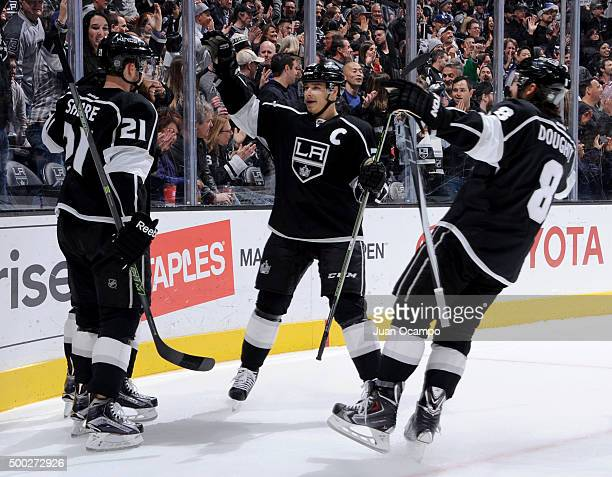 Nick Shore Andy Andreoff Dustin Brown and Drew Doughty of the Los Angeles Kings celebrate Andreoff's first period goal against the Tampa Bay...