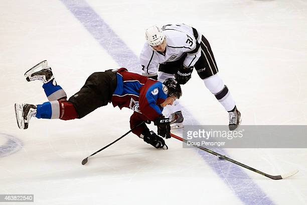 Nick Shore of the Los Angeles Kings draws a penalty for hooking against Matt Duchene of the Colorado Avalanche at Pepsi Center on February 18 2015 in...