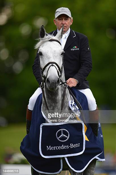 Nick Skelton of Great Britain and Carlo pose during the award ceremony after the MercedesBenz Championat of Hamburg during day one of the German...
