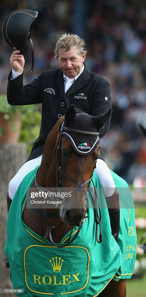 <a gi-track='captionPersonalityLinkClicked' href=/galleries/search?phrase=Nick+Skelton&family=editorial&specificpeople=227134 ng-click='$event.stopPropagation()'>Nick Skelton</a> of Great-Britain ride on rides on Big Star and won the Rolex Grand Prix jumping competition during the 2013 CHIO Aachen tournament on June 30, 2013 in Aachen, Germany.