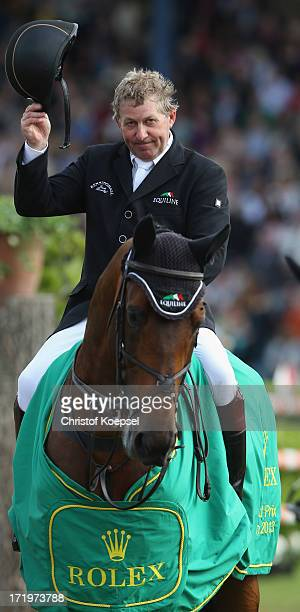 Nick Skelton of GreatBritain ride on rides on Big Star and won the Rolex Grand Prix jumping competition during the 2013 CHIO Aachen tournament on...