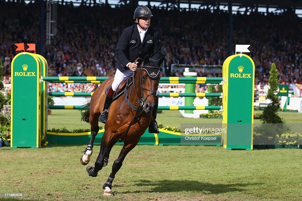 <a gi-track='captionPersonalityLinkClicked' href=/galleries/search?phrase=Nick+Skelton&family=editorial&specificpeople=227134 ng-click='$event.stopPropagation()'>Nick Skelton</a> of Great-Britain ride on rides ons rides on Big Star on won the Rolex Grand Prix jumping competition during the 2013 CHIO Aachen tournament on June 30, 2013 in Aachen, Germany.