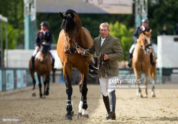 Nick Skelton walks his horse Big Star around the arena as they retire at the Royal Windsor Horse Show which is held in the grounds of Windsor Castle...