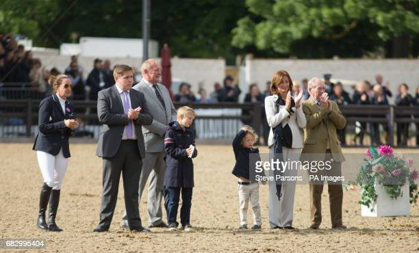Nick Skelton's family watch as he walks his horse Big Star around the arena as they retire at the Royal Windsor Horse Show which is held in the...