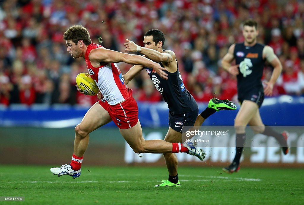 Nick Smith of the Swans is tackled by Jeff Garlett of the Blues during the AFL First Semi Final match between the Sydney Swans and the Carlton Blues at ANZ Stadium on September 14, 2013 in Sydney, Australia.
