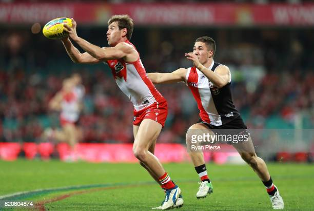 Nick Smith of the Swans marks over Shane Savage of the Saints during the round 18 AFL match between the Sydney Swans and the St Kilda Saints at...