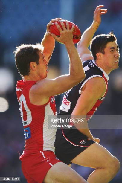 Nick Smith of the Swans marks the ball against Jade Gresham of the Saints during the round nine AFL match between the St Kilda Saints and the Sydney...