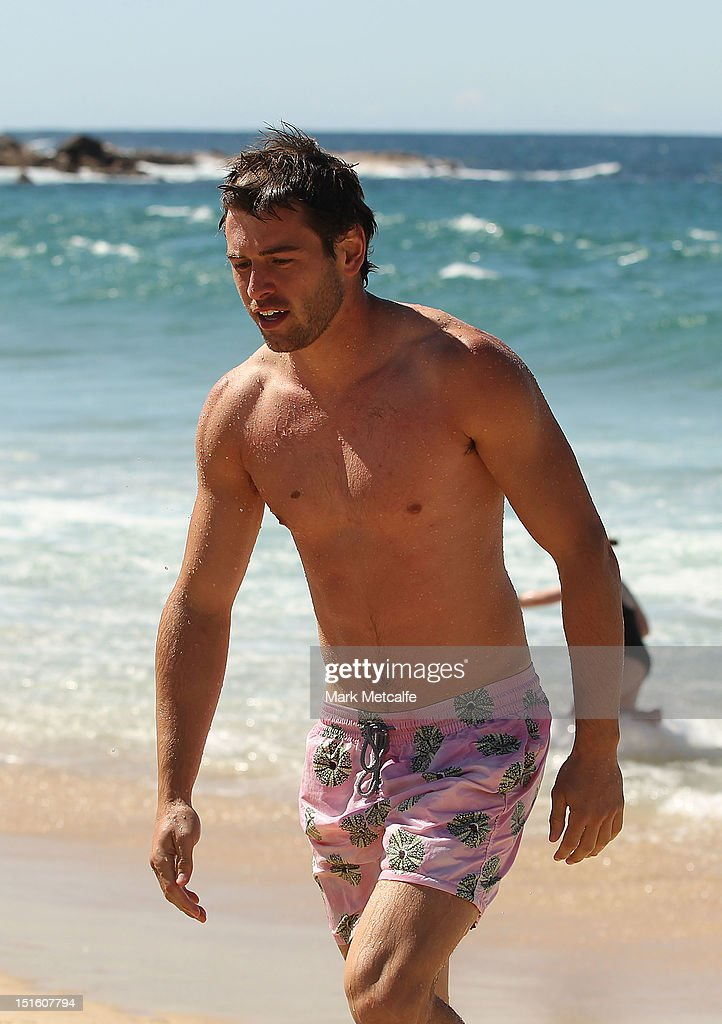 Nick Smith of the Swans walks out of the ocean during a Sydney Swans media session at Coogee Beach on September 9, 2012 in Sydney, Australia.