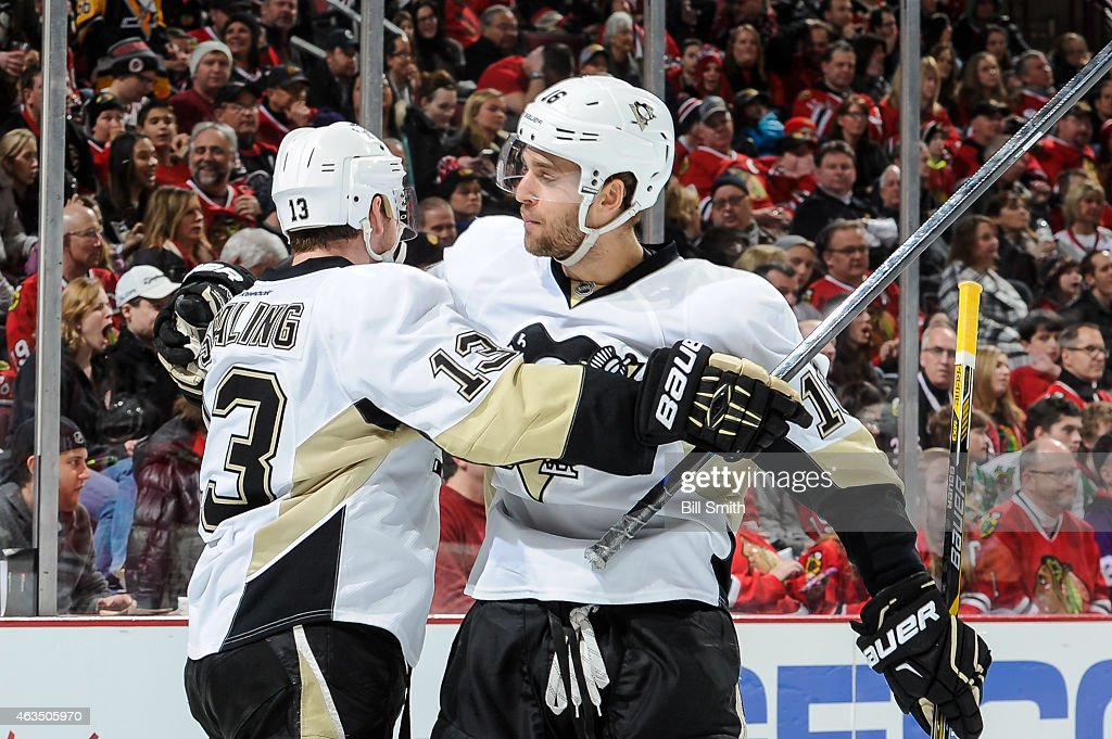 Nick Spaling and Brandon Sutter of the Pittsburgh Penguins celebrate after Spaling scored against the Chicago Blackhawks in the third period during...