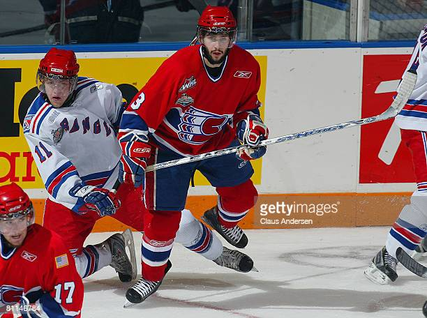 Nick Spaling of the Kitchener Rangers is knocked to the ice by Trevor Glass of the Spokane Chiefs in a Memorial Cup round robin game on May 18 2008...