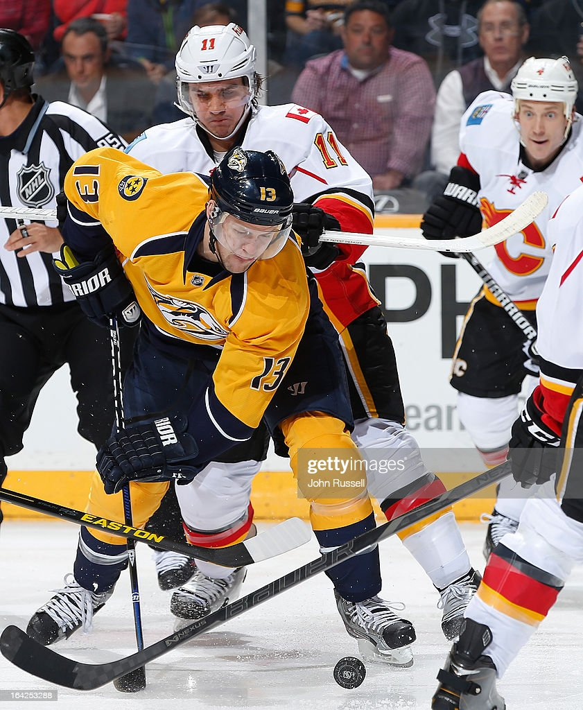 <a gi-track='captionPersonalityLinkClicked' href=/galleries/search?phrase=Nick+Spaling&family=editorial&specificpeople=4112920 ng-click='$event.stopPropagation()'>Nick Spaling</a> #13 of the Nashville Predators battles for the loose puck against <a gi-track='captionPersonalityLinkClicked' href=/galleries/search?phrase=Mikael+Backlund&family=editorial&specificpeople=4324942 ng-click='$event.stopPropagation()'>Mikael Backlund</a> #11 of the Calgary Flames during an NHL game at the Bridgestone Arena on March 21, 2013 in Nashville, Tennessee.