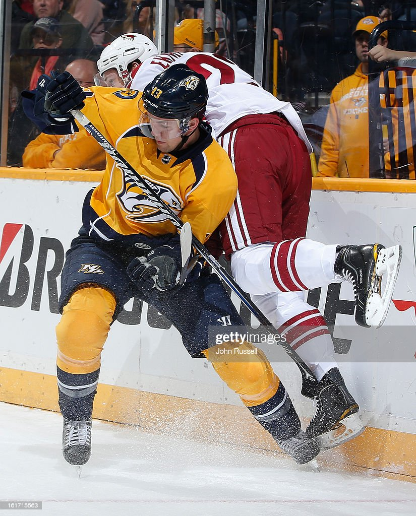 Nick Spaling #13 of the Nashville Predators checks Oliver Ekman-Larsson #23 of the Phoenix Coyotes during an NHL game at the Bridgestone Arena on February 14, 2013 in Nashville, Tennessee.