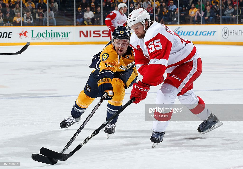 <a gi-track='captionPersonalityLinkClicked' href=/galleries/search?phrase=Nick+Spaling&family=editorial&specificpeople=4112920 ng-click='$event.stopPropagation()'>Nick Spaling</a> #13 of the Nashville Predators forechecks against <a gi-track='captionPersonalityLinkClicked' href=/galleries/search?phrase=Niklas+Kronwall&family=editorial&specificpeople=220826 ng-click='$event.stopPropagation()'>Niklas Kronwall</a> #55 of the Detroit Red Wings at Bridgestone Arena on December 30, 2013 in Nashville, Tennessee.