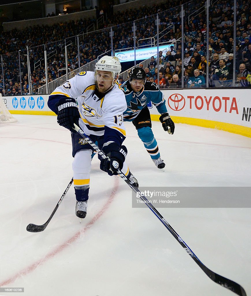 Nick Spaling #13 of the Nashville Predators passes the puck against the San Jose Sharks at HP Pavilion on February 2, 2013 in San Jose, California.