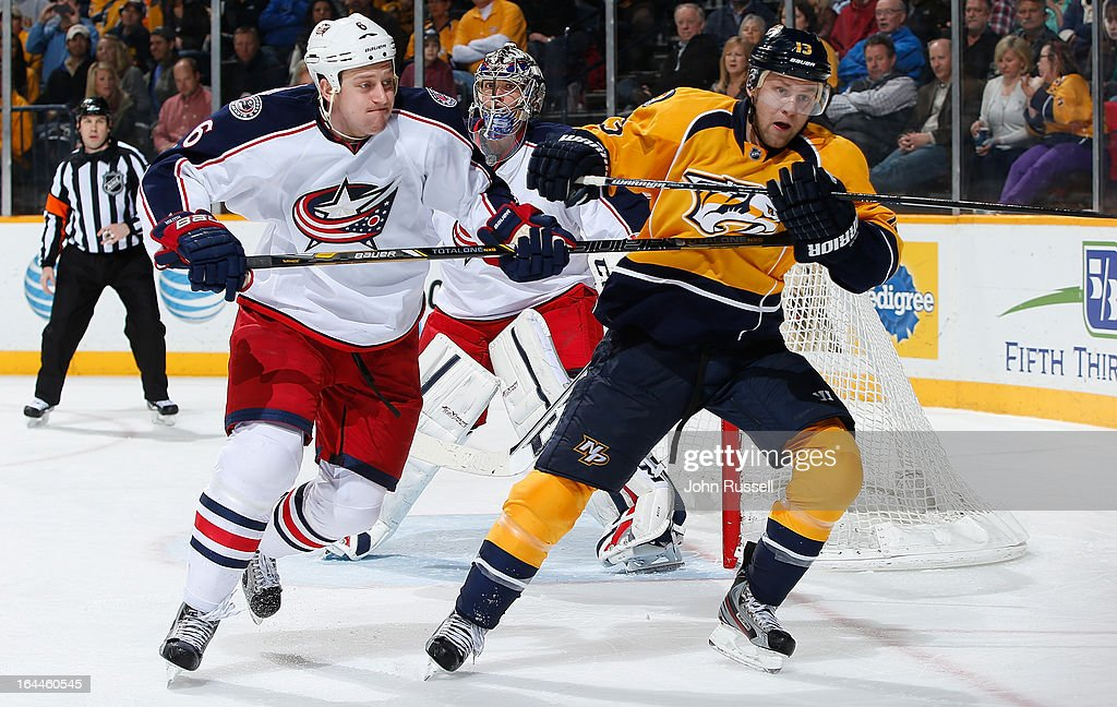 Nick Spaling #13 of the Nashville Predators skates against Nikita Nikitin #6 of the Columbus Blue Jackets during an NHL game at the Bridgestone Arena on March 23, 2013 in Nashville, Tennessee.
