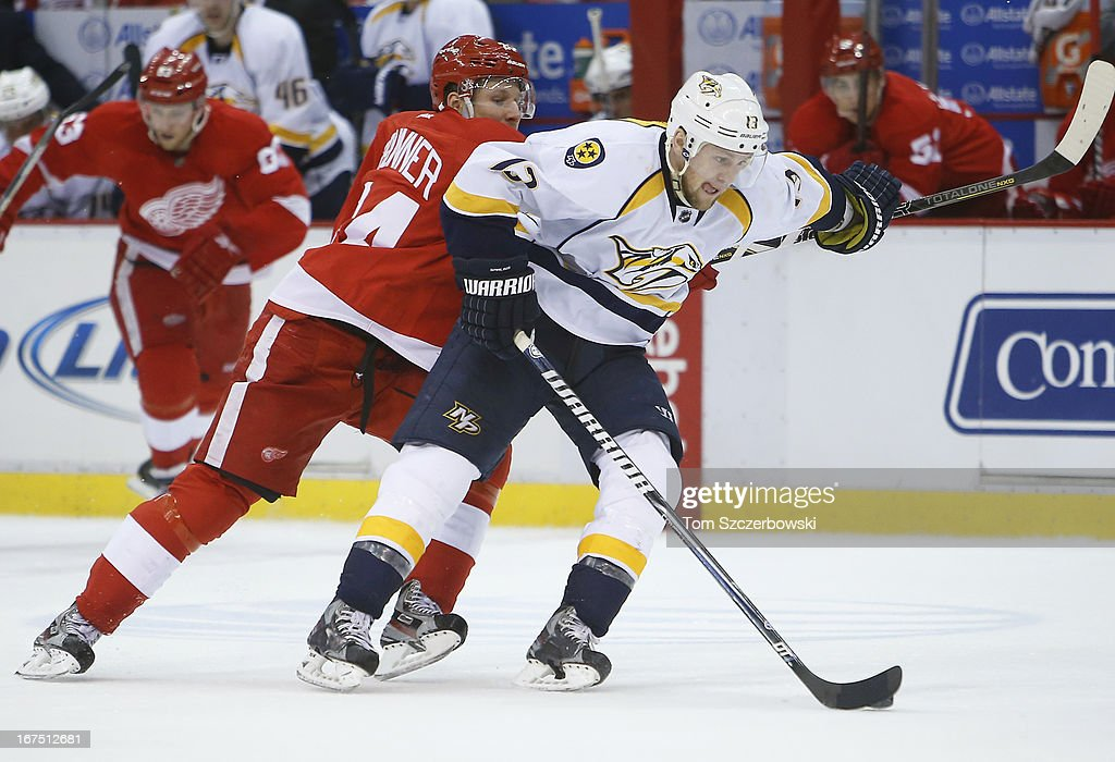 <a gi-track='captionPersonalityLinkClicked' href=/galleries/search?phrase=Nick+Spaling&family=editorial&specificpeople=4112920 ng-click='$event.stopPropagation()'>Nick Spaling</a> #13 of the Nashville Predators skates with the puck during an NHL game as <a gi-track='captionPersonalityLinkClicked' href=/galleries/search?phrase=Damien+Brunner&family=editorial&specificpeople=6931570 ng-click='$event.stopPropagation()'>Damien Brunner</a> #24 of the Detroit Red Wings backchecks at Joe Louis Arena on April 25, 2013 in Detroit, Michigan.