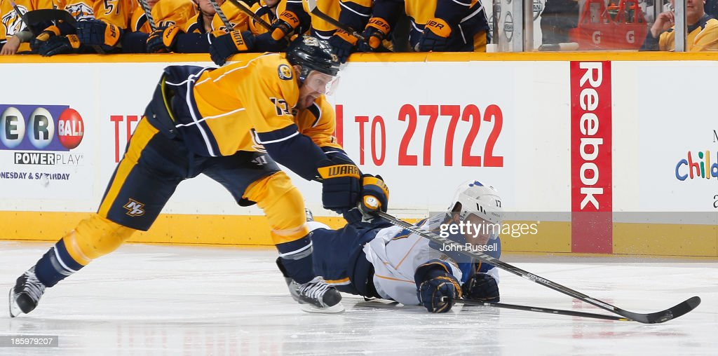 <a gi-track='captionPersonalityLinkClicked' href=/galleries/search?phrase=Nick+Spaling&family=editorial&specificpeople=4112920 ng-click='$event.stopPropagation()'>Nick Spaling</a> #13 of the Nashville Predators steal the puck on a break against <a gi-track='captionPersonalityLinkClicked' href=/galleries/search?phrase=Vladimir+Sobotka&family=editorial&specificpeople=716736 ng-click='$event.stopPropagation()'>Vladimir Sobotka</a> #17 of the St. Louis Blues at Bridgestone Arena on October 26, 2013 in Nashville, Tennessee.