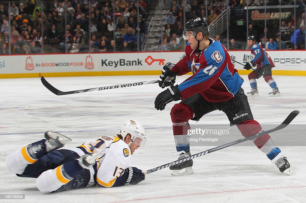 Nick Spaling #13 of the Nashville Predators stops the puck with his body as he blocks a shot by Paul Stastny #26 of the Colorado Avalanche at the Pepsi Center on January 10, 2012 in Denver, Colorado. The Predators defeated the Avalanche 4-1.