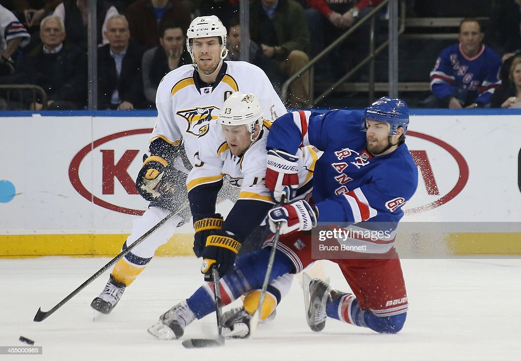 <a gi-track='captionPersonalityLinkClicked' href=/galleries/search?phrase=Nick+Spaling&family=editorial&specificpeople=4112920 ng-click='$event.stopPropagation()'>Nick Spaling</a> #13 of the Nashville Predators upends <a gi-track='captionPersonalityLinkClicked' href=/galleries/search?phrase=Rick+Nash&family=editorial&specificpeople=202196 ng-click='$event.stopPropagation()'>Rick Nash</a> #61 of the New York Rangers during the first period at Madison Square Garden on December 10, 2013 in New York City. The Predators defeated the Rangers 4-1.