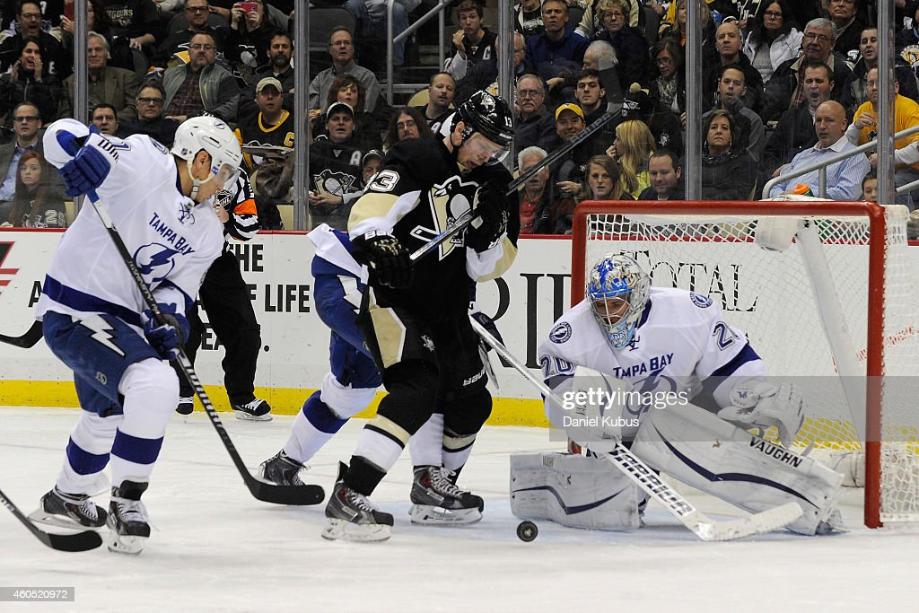 Nick Spaling of the Pittsburgh Penguins fights for a loose puck in front of Evgeni Nabokov of the Tampa Bay Lightning in the third period at Consol...