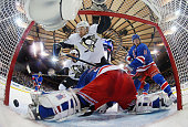 Nick Spaling of the Pittsburgh Penguins scores at 1723 of the second period against Henrik Lundqvist of the New York Rangers in Game Five of the...