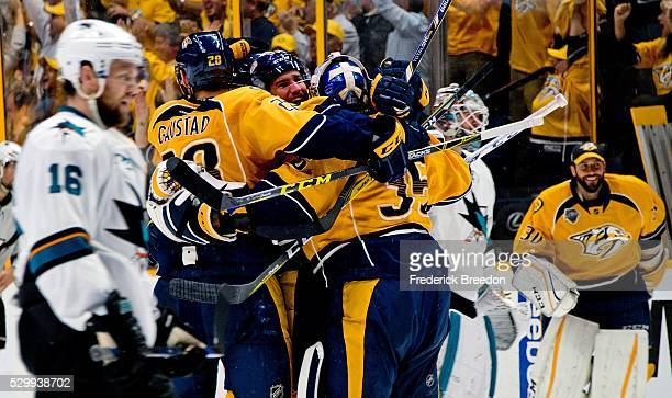 Nick Spaling of the San Jose Sharks skates by as Paul Gaustad and Pekka Rinne of the Nashville Predators celebrate with Roman Josi after a 43...