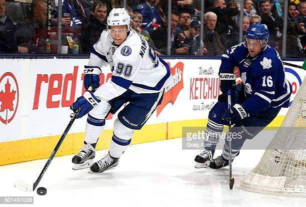 Nick Spaling of the Toronto Maple Leafs chases Vladislav Namestnikov of the Tampa Bay Lightning during game action on December 15 2015 at Air Canada...