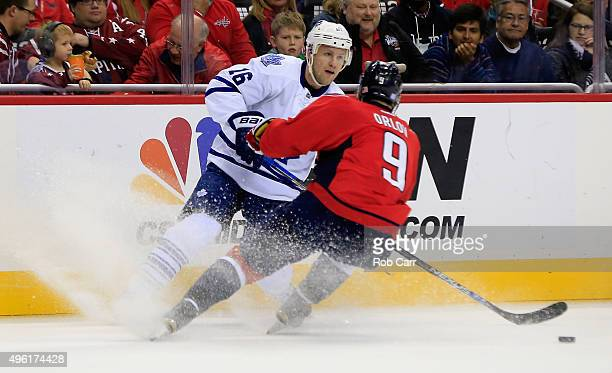 Nick Spaling of the Toronto Maple Leafs passes the puck past Dmitry Orlov of the Washington Capitals duirng the first period at Verizon Center on...