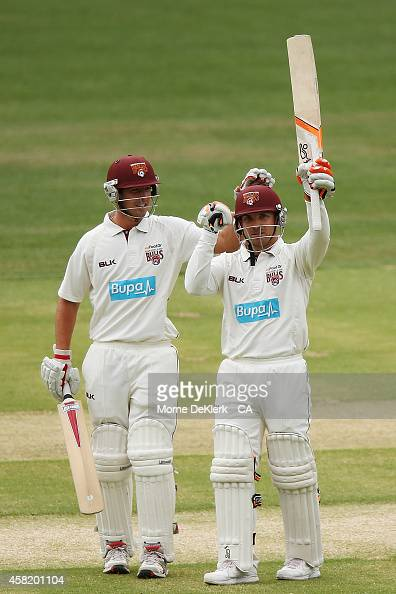 Nick Stevens of the Bulls congratulate teammate Chris Hartley after Hartley reached 100 runs during day two of the Sheffield Shield match between...