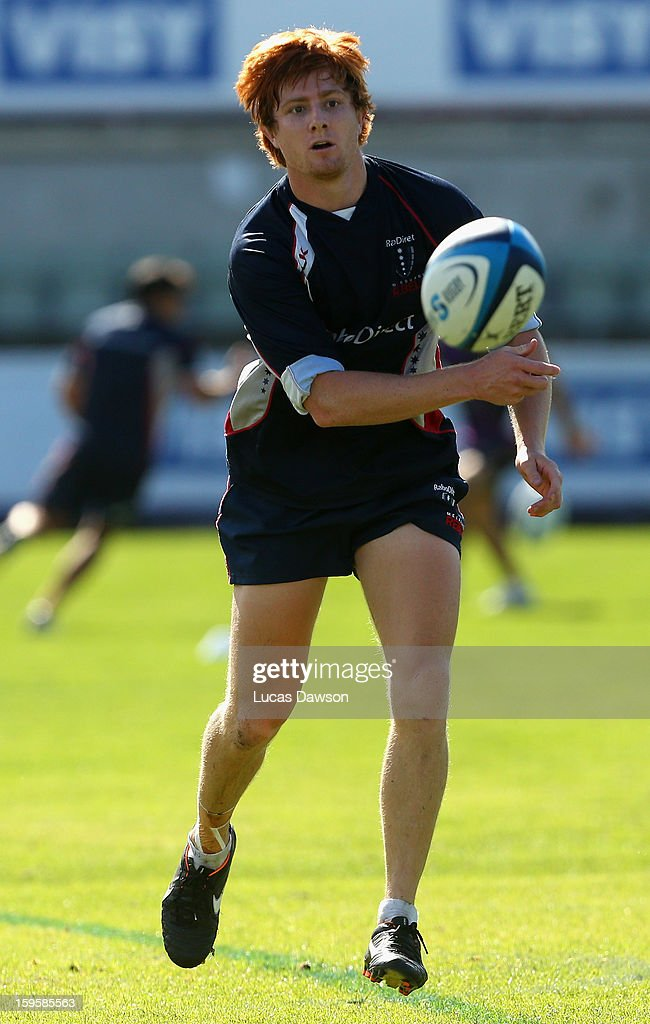 Nick Stirzaker of the Rebels passes the ball during a Melbourne Storm and Melbourne Rebels training session at Visy Park on January 17, 2013 in Melbourne, Australia.